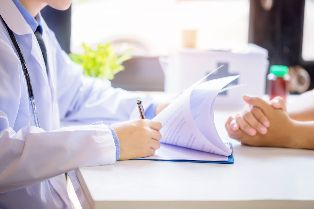 doctor diagnosing patient with hypertension